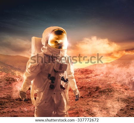 Astronaut walking on an unexplored planet #337772672