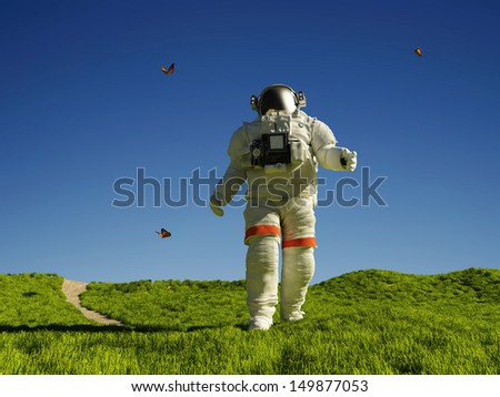"""Astronaut walking on the green grass.""""Elemen ts of this image furnished by NASA"""""""