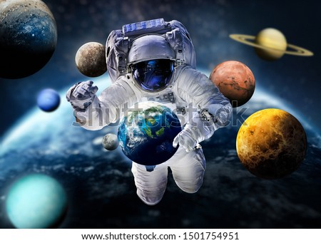 Astronaut with planets of Solar System. Earth, Mars, Jupiter. Background for infographics. Planet on the background. ABstract wallpaper. Elements of this image furnished by NASA