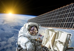 Astronaut work on the space station - Elements of this image furnished by NASA