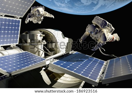 Astronauts in space around the solar battarei. Elem en ts of this image furnished by NASA