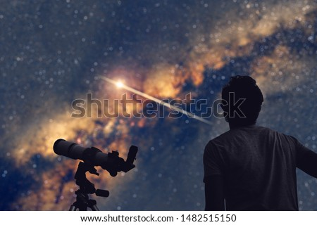 Astronomer with a telescope watching at the stars and Moon.  Stock photo ©