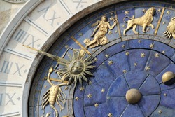 Astronomical Clock Tower (Torre dell'Orologio) Details. St. Mark's Square (Piazza San Marko), Venice, Italy. Low Angle, Tilt view.