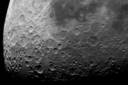 Astronomical photograph of the moon. Lunar surface through a telescope. The moon with a large increase. Craters after hitting meteorites. The Moon is the Earth's satellite. Natural background.
