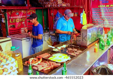 ASUNCION, PARAGUAY - DECEMBER 26: Unidintified men cook at the food stall at Mercado Cuatro on December 26, 2014 in Asuncion, Paraguay. Asuncion is the capital and the largest city of Paraguay #465552023