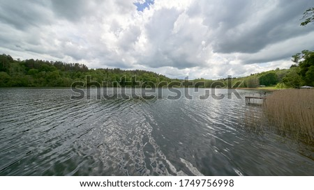 Photo of  Asveja Regional Park. Heavy clouds over a lake Asveja on a windy day. Lake Asveja in cloudy day, Aukstaitija region, Lithuania. June 2020.