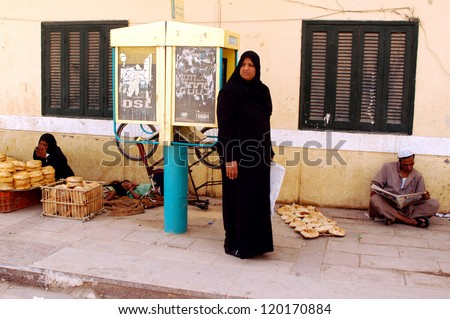 ASWAN - APRIL 28: Muslim women dressing Hijab in Aswan market, Egypt on April 28 2007.The meaning of the Muslim dressing cod is modesty, privacy, and morality.