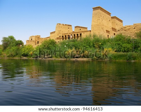 Aswan, Egypt: The amazing Temple of Isis at Philae island in Lake Nasser, seen from a boat. Located at 11 km of Aswan, Egypt