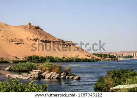 Aswan view on the Nile river and the tombs of nobles.