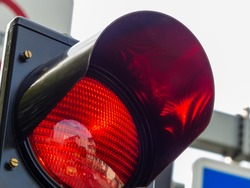 at a traffic light, the red light is lit. symbolic photo for holding