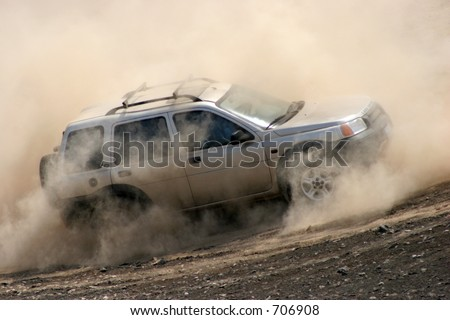 At a 4x4 event, an offroader naviagtes in deep dust and sand. South of Lima, Peru.