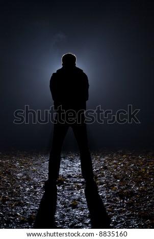 At dark night on a wood the maniac follows girls