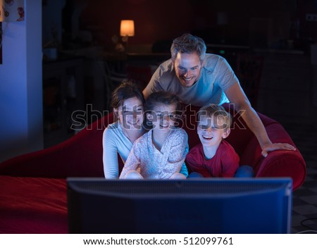 Family Watching Tv At Night
