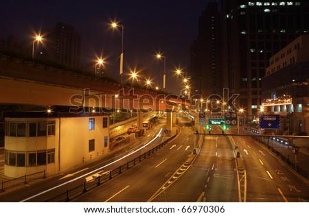 At night illuminated street in Shanghai, China