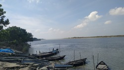 At noon time capture Ganga raver, sky and board natural picture