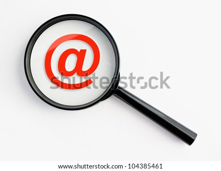 at symbol under a magnifying glass, with isolated background