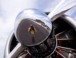 AT-6 Texan, known as the Harvard training plane engine with reflection of photographer in propeller