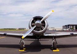 AT-6 Texan, known as the Harvard training plane on runway