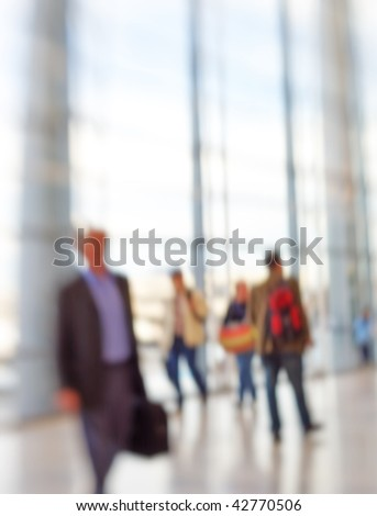 At the airport - intentional lens and motion blurred business people