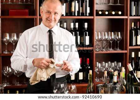 At the bar - waiter clean glass with dish clove  restaurant