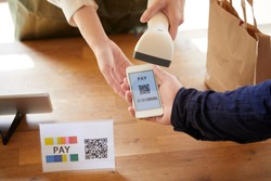 At the cash register where payment is made using a smartphone