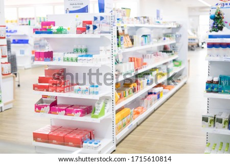 At the chemist, Medicines arranged in shelves, Pharmacy drugstore retail Interior blur abstract backbround with medicine and healthcare product on cabinet with ืneon light with vaccine.