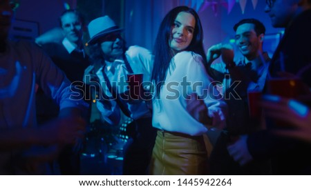 At the Club Party: Diverse Group of Friends Have Fun, Dance, Jump, Socialize and Drink. Stylish Young People Clubbing. Disco Neon Lights.