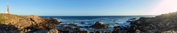 At the coast of Cabo Polonio, Uruguay, South America - Panorama of the lighthouse, rocky coast and Atlantic Ocean