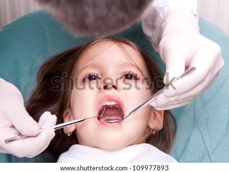at the dentist - little girl have dental examination
