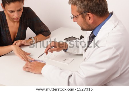at the doctor's office - doctor explainig diagnosis to his female patient