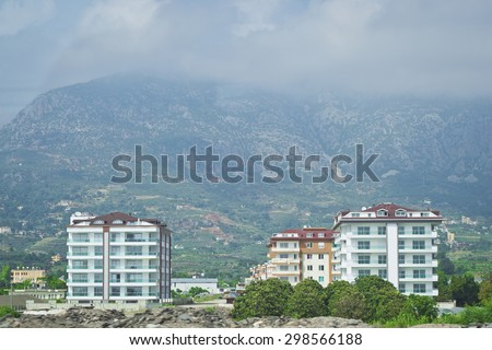 At the foot of the mountains. Tenement house in the village of Kemer, standing at the foot of the mountains