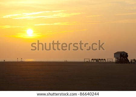 At the german beach of Sankt Peter Ording during sunset - stock photo
