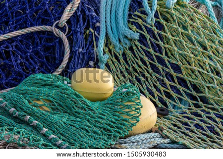 at the harbor site the color-full fishing nets are waiting for there next job.