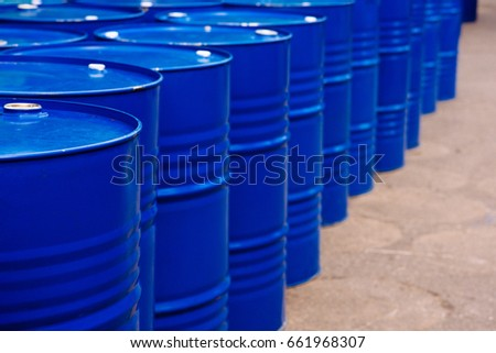 At the industrial event is a warehouse of blue barrels of hydrocarbons. Oil. Barrels.