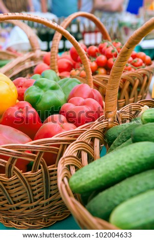 At the market. Basket with free vegetables .
