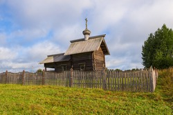 At the old wooden chapel of St. Nicholas the Wonderworker on an August day. Gomorovichi, Leningrad region. Russia