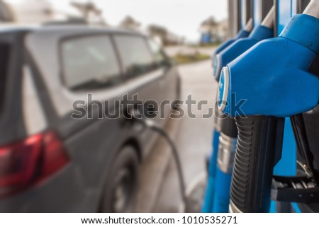 At the petrol station, a car is fueled with diesel. Concept: transport and traffic  #1010535271