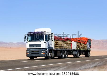 ATACAMA, CHILE - NOVEMBER 14, 2015: Modern truck MAN TGA at the interurban freeway through the Atacama desert.