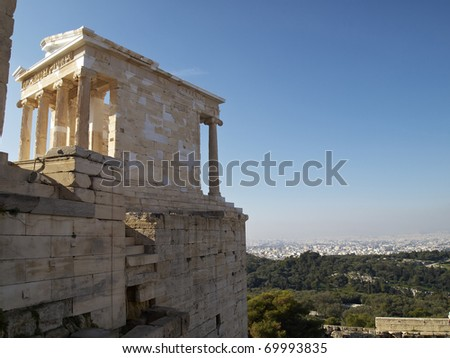Athena Nike temple Acropolis, and Athens cityscape, Greece. Room for type