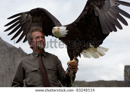 ATHENRY, IRELAND - AUGUST 21: Lothar Muschketat with Bald Headed Eagle takes part in the annual National Walled Towns Day  on August 21, 2011 in Athenry, Ireland.