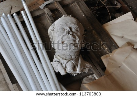 ATHENS - FEBRUARY 3: Broken sculpture head of adult man among debris in the abandoned studio of sculptor Nikolaos Pavlopoulos, Athens Greece, February 3, 2012.