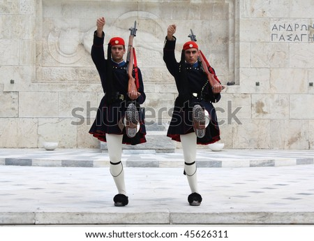 ATHENS, GREECE - APRIL 21: Evzones (presidential ceremonial guards) guard the Tomb of the Unknown Soldier at the Greek Parliament Building, opposite Syntagma Square, April 21, 2009 in Athens, Greece.