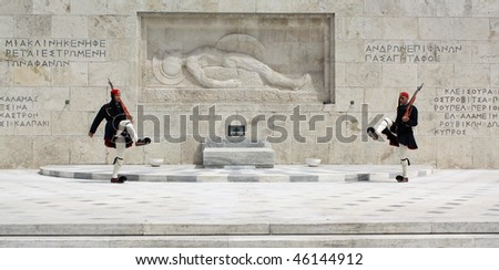 ATHENS, GREECE - APRIL 21: Evzones (presidential ceremonial guards) guarding the Tomb of the Unknown Soldier at the Hellenic Parliament Building, April 21, 2009 in Athens, Greece.