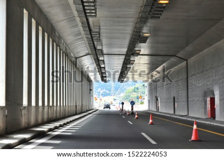 Athens / Greece - August 2019. Road tunnel in mountains. Mountain road tunnel Tunnel on the highway.  Automobile trip. Pathway with tunnel. Drive through the mountain #1522224053