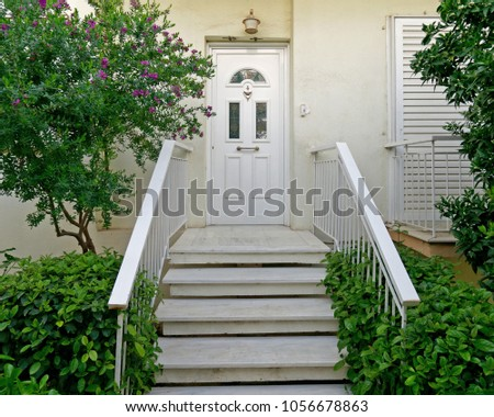 Athens Greece, contemporary house entrance stairs and white door