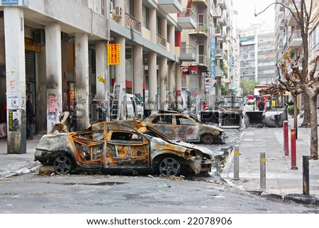 ATHENS (GREECE) - December 15: Burnt cars placed as a barricade by rioters in an Athens downtown street during the big riots caused by the death of a teenage student after being shot by a policeman