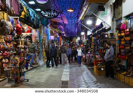 Athens, Greece - December 04, 2015: People at  the shops of the flea market in the Monastiraki area in Plaka, Athens