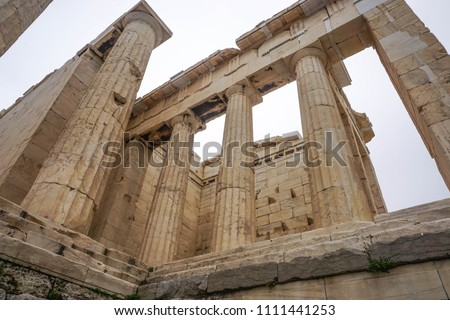 Athens, Greece: Detail of the Propyla (entrance) of the Acropolis of Athens, under a hazy sky caused by dust pollution.