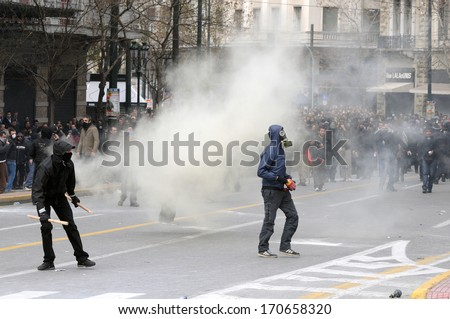 ATHENS, GREECE-FEB.23.  Protesters provoking police during demonstration in Athens, February 23, 2011.