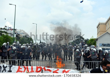 ATHENS, GREECE -JUNE15. A molotov explodes next to riot police at the Greek Parliament during demonstration , in Athens, June 15, 2011.